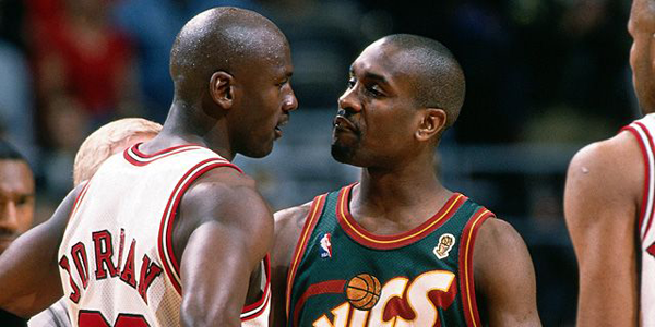 Michael Jordan (left) and Gary Payton (right) amidst a trash talking exchange.