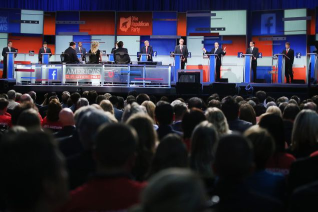 CLEVELAND, OH - AUGUST 06:  Guests watch Republican presidential candidates speak during the first Republican presidential debate hosted by Fox News and Facebook at the Quicken Loans Arena on August 6, 2015 in Cleveland, Ohio. The top ten GOP candidates were selected to participate in the debate based on their rank in an average of the five most recent political polls.  (Photo by Scott Olson/Getty Images)