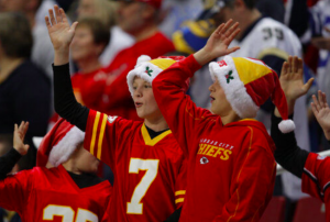 Kansas City Chiefs fans celebrate with the tomahawk chop during the fourth quarter of an NFL football game against the St. Louis Rams in St. Louis (December 19, 2010)