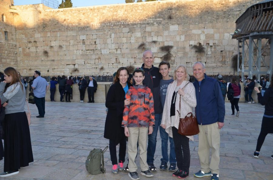 My family and I standing next to the Western Wall, the holiest site in Israel for Jews in Spring 2019.